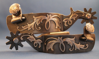 Custom-made spurs with silver overlay.